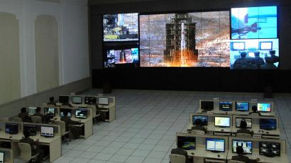 North Korean scientists work as a screen shows the Unha-3 (Milky Way 3) rocket being launched from a launch pad at the West Sea Satellite Launch Site, at the satellite control centre in Cholsan county, North Pyongan province in this picture released by the North's official KCNA news agency in Pyongyang December 12, 2012. KCNA said the picture was taken December 12, 2012.