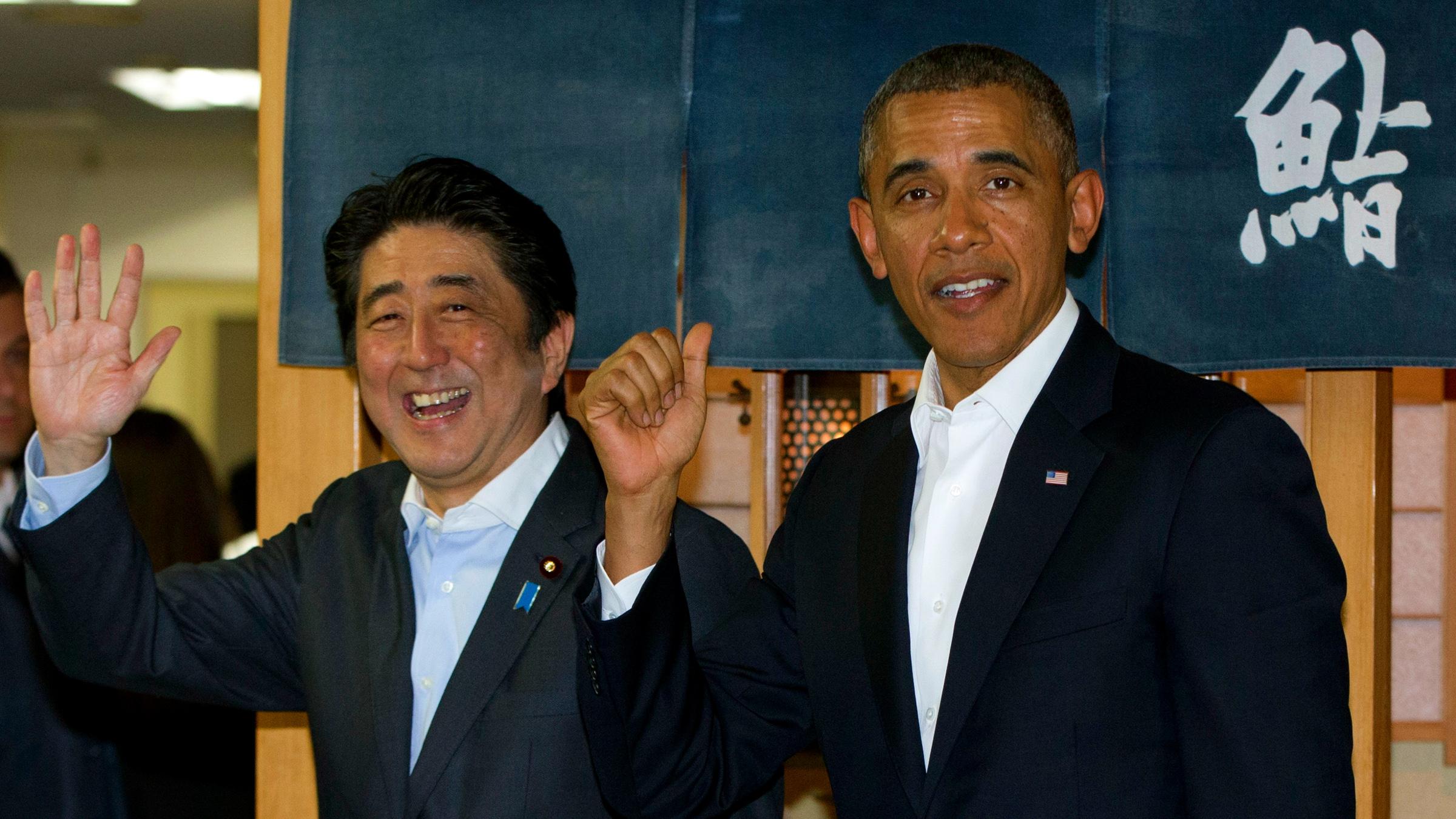 President Barack Obama and Japanese Prime Minister Shinzo Abe depart Sukiyabashi Jiro sushi restaurant inTokyo, Wednesday, April 23, 2014. President Obama begins a four-country trip through the Asia-Pacific region.
