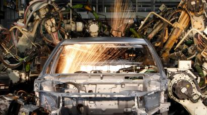 Robots weld the bodyshell of a Toyota Camry Hybrid car