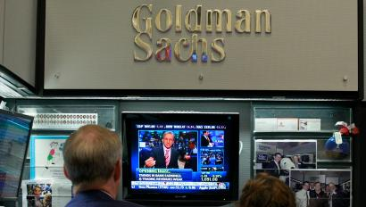 Goldman Sachs traders watching business news on TV