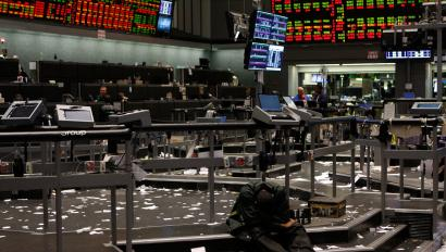 Traders slumps on the stairs in an empty exchange floor