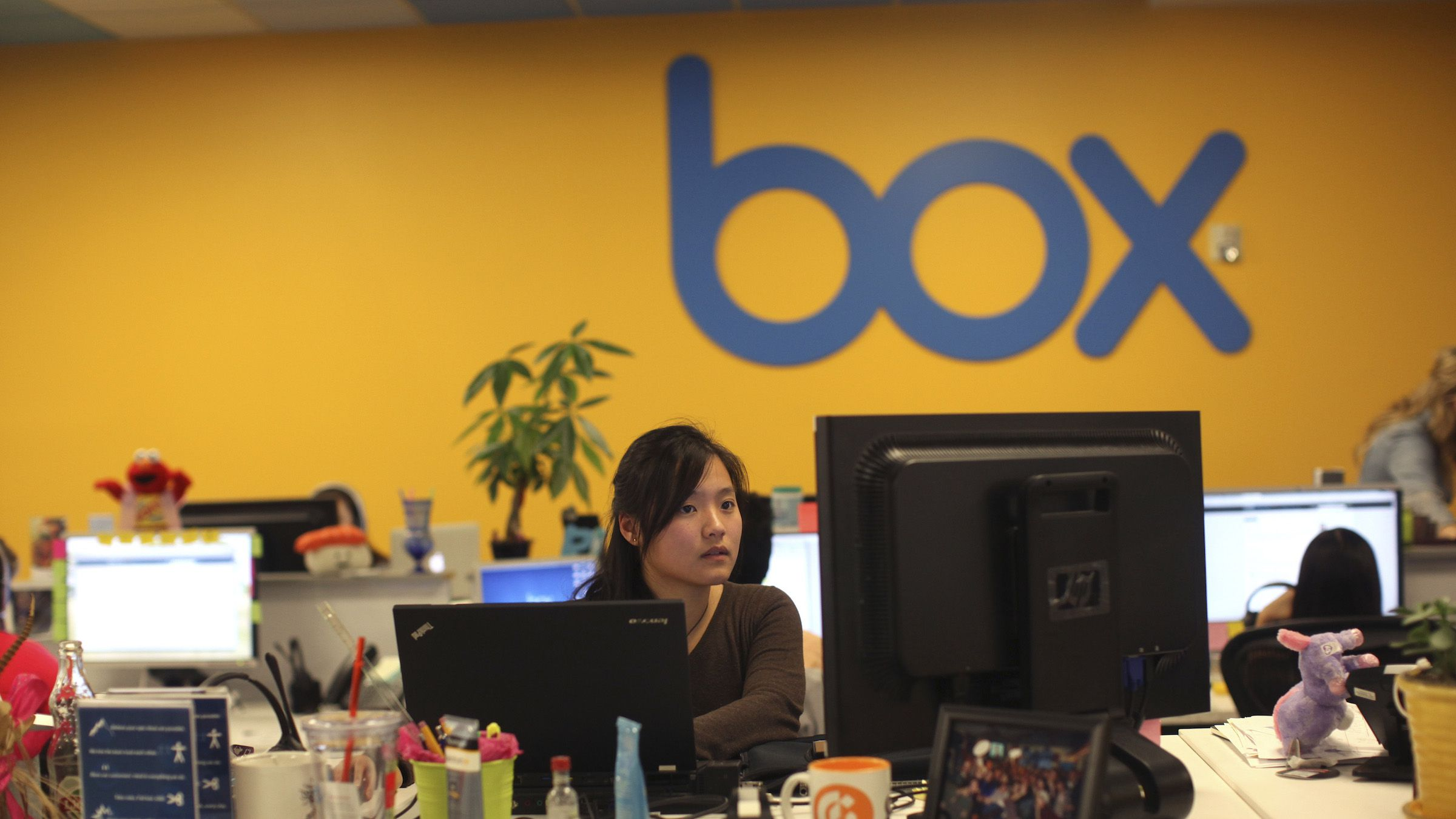 Employees work at Box Inc.'s headquarters