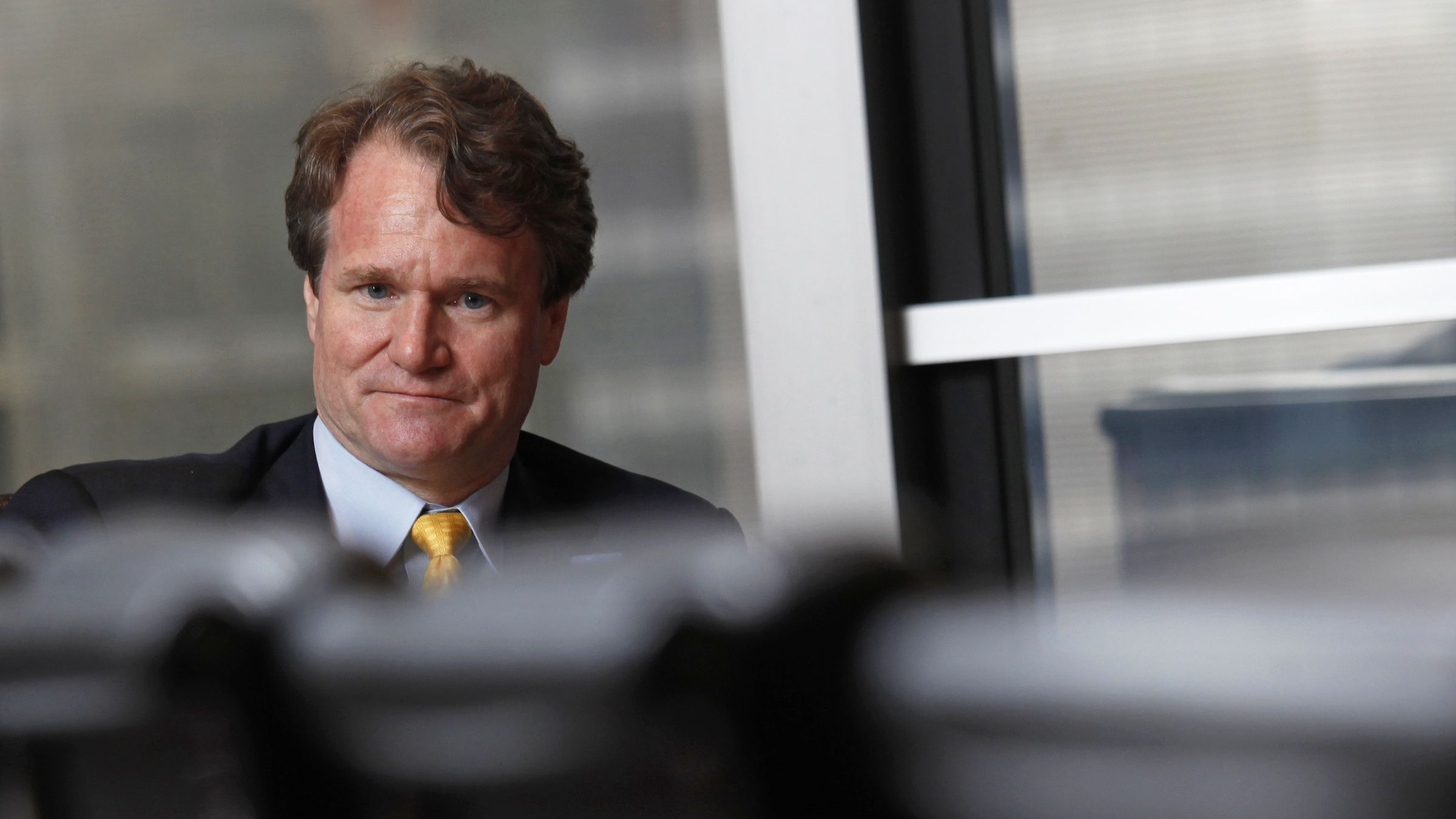 Bank of America Chief Executive Brian Moynihan looks on during an interview in Hong Kong