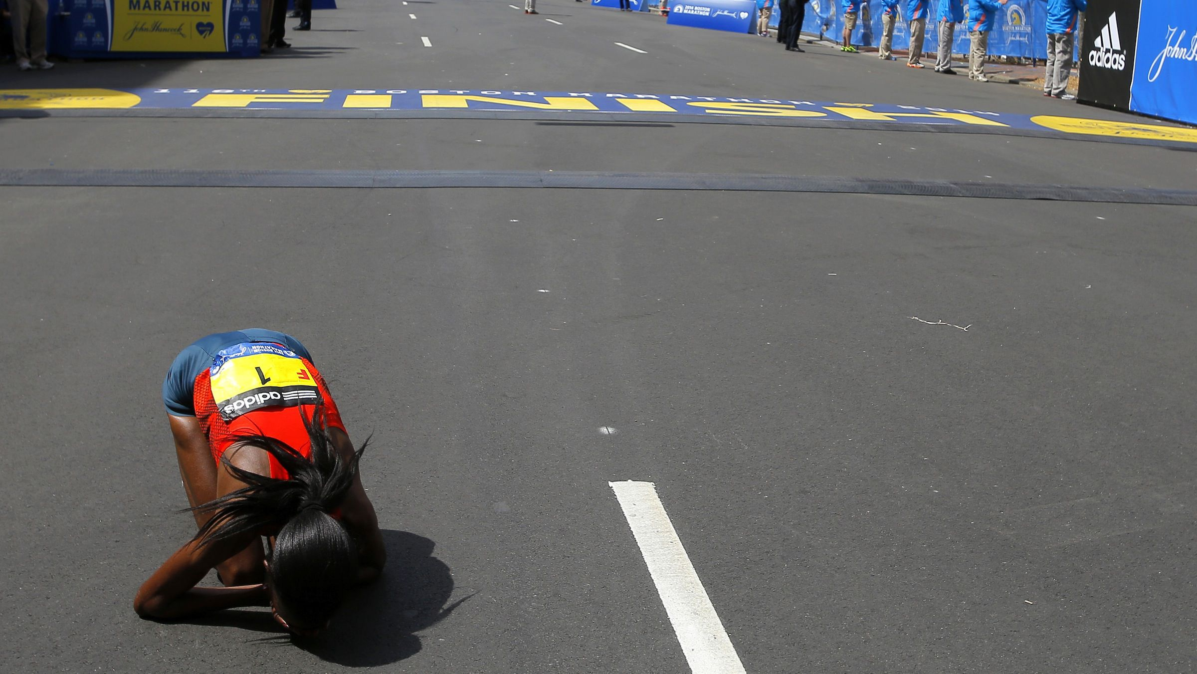 Rita Jeptoo of Kenya reacts after winning the women's division of the 118th running of the Boston Marathon in Boston, Massachusetts April 21, 2014.   REUTERS/Brian Snyder (UNITED STATES - Tags: SPORT ATHLETICS) - RTR3M3UR