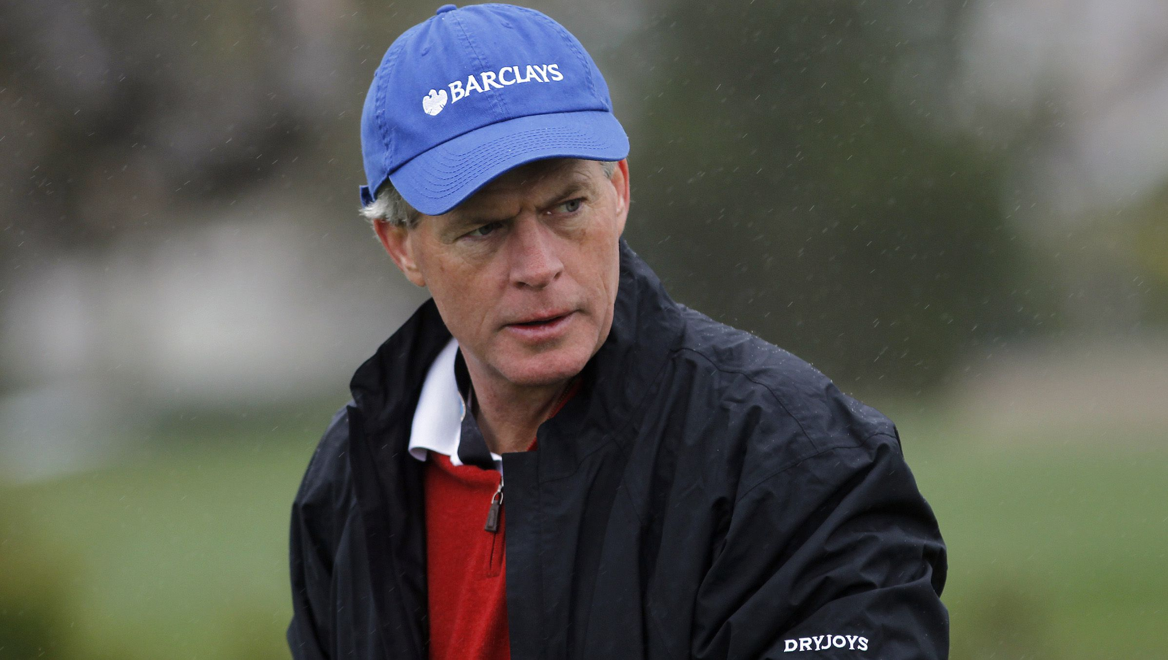 Skip McGee III dons a rain jacket during the second round of the Pebble Beach National Pro-Am