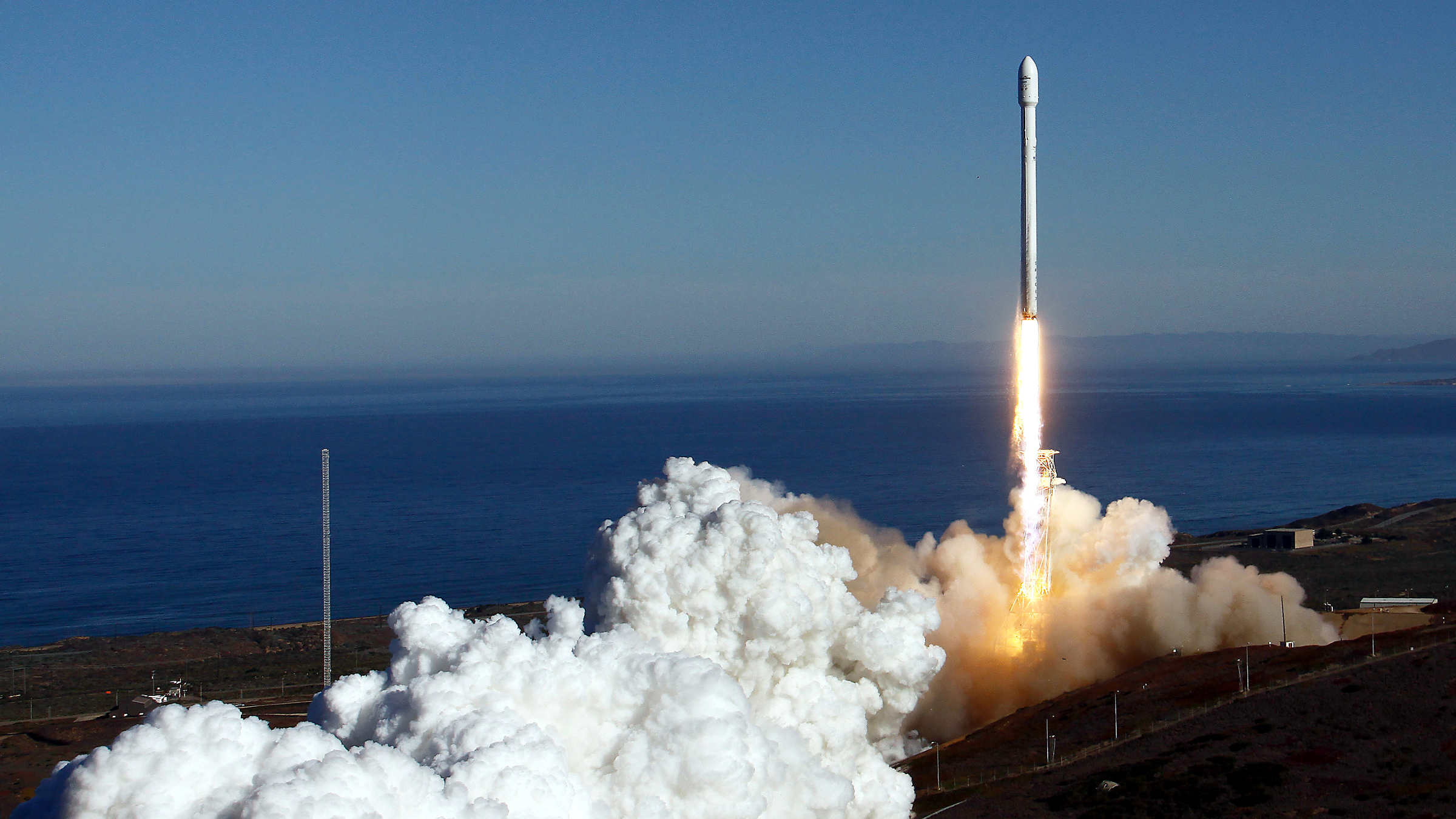 A Falcon 9 rocket carrying a small science satellite for Canada is seen as it is launched from a newly refurbished launch pad in Vandenberg Air Force Station September 29, 2013. The unmanned rocket blasted off from California on Sunday to test upgrades needed for planned commercial launch services. The 22-story rocket, built and flown by Space Exploration Technologies, or SpaceX, soared off a newly refurbished, leased launch pad at Vandenberg Air Force Station at noon EDT/1600 GMT (05.00 p.m. British time).