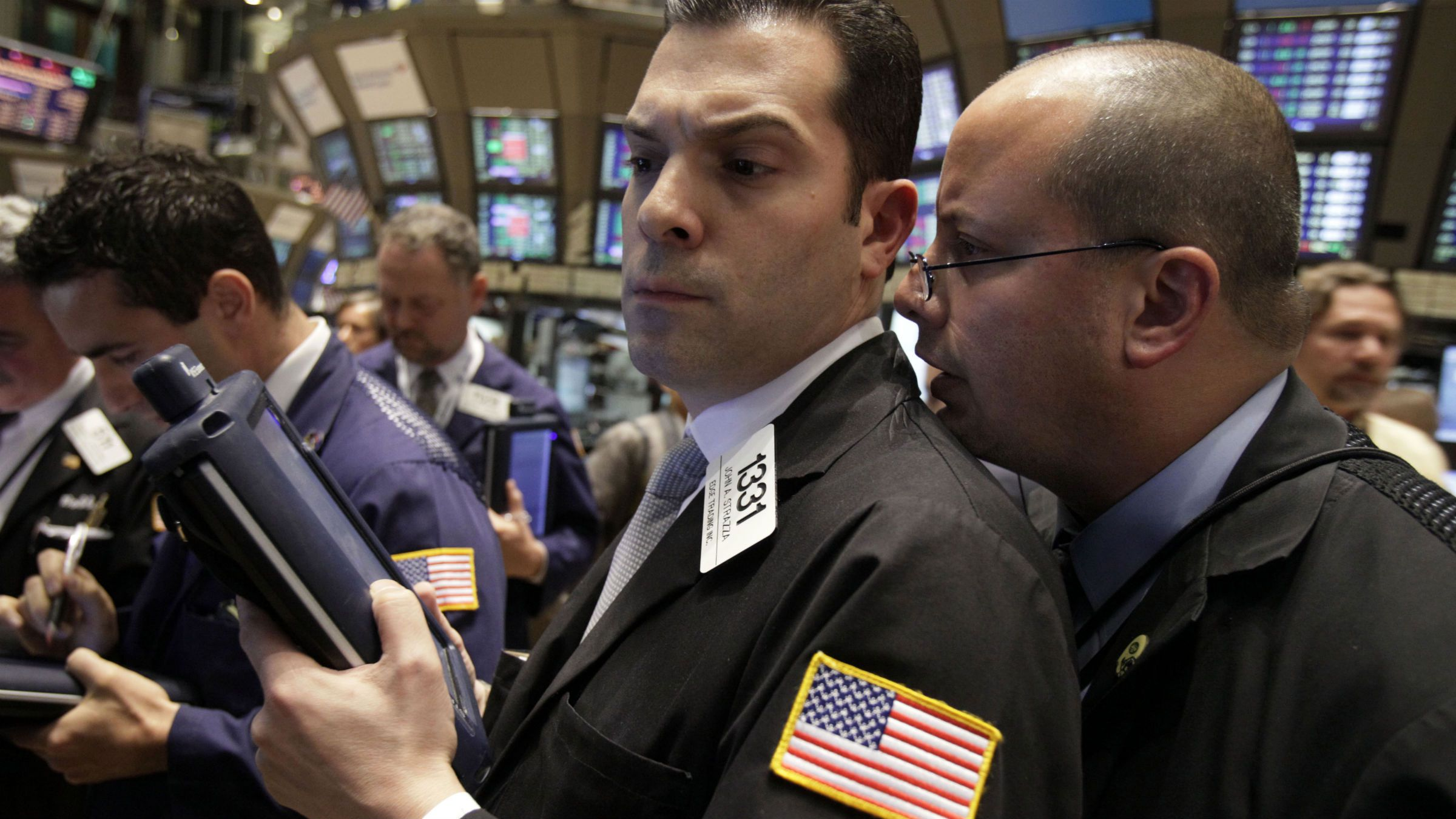 One trader whispering to another on the floor of the New York Stock Exchange.