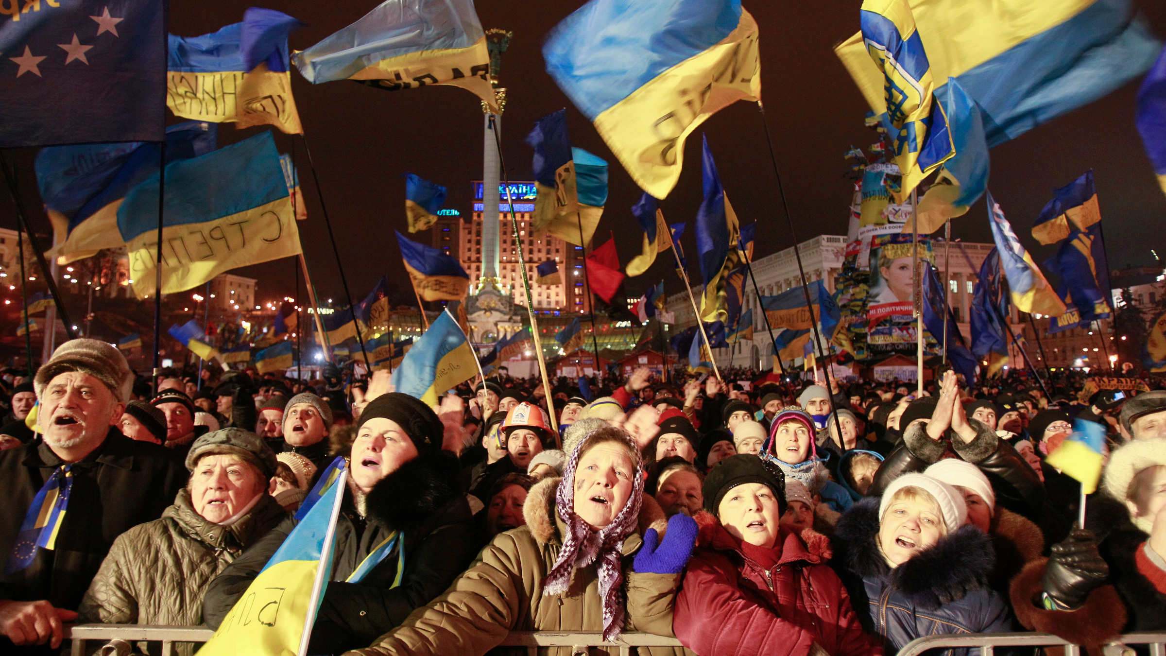 Pro-European integration protesters attend a rally in Maidan Nezalezhnosti on Independence Square in central Kiev, December 17, 2013. Russia threw Ukraine an economic lifeline on Tuesday, agreeing to buy $15 billion (£9.23 billion) of Ukrainian debt and to reduce the price its cash-strapped neighbour pays for vital Russian gas supplies by about one-third.
