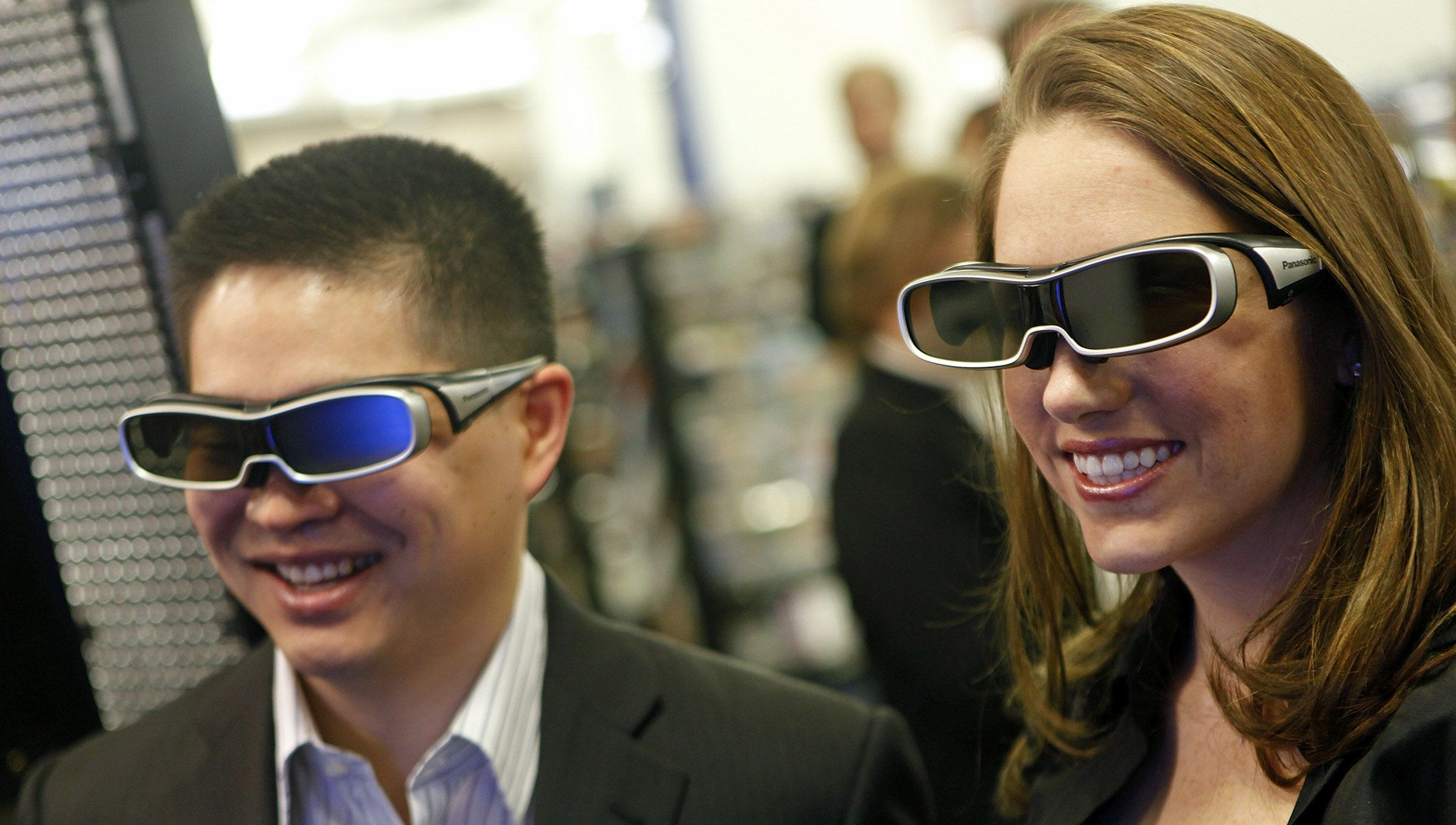 Brad, left, and Ashley Katsuyama, sample Panasonic's 3D technology before becoming the world's first consumers to purchase a complete 3D home theater system at Best Buy Wednesday March 10, 2010 in New York. (David Goldman/AP Images for Best Buy )