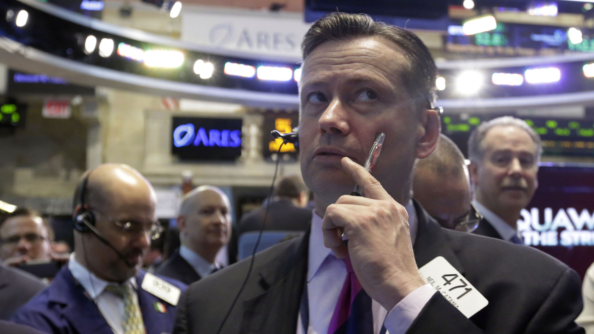 Trader Neil Catania, center, works on the floor of the New York Stock Exchange, Friday, May 2, 2014. U.S. stock futures are up slightly after the U.S. unemployment rate hit its lowest level in more than five years. The government reported the unemployment rate sank to 6.3 percent.