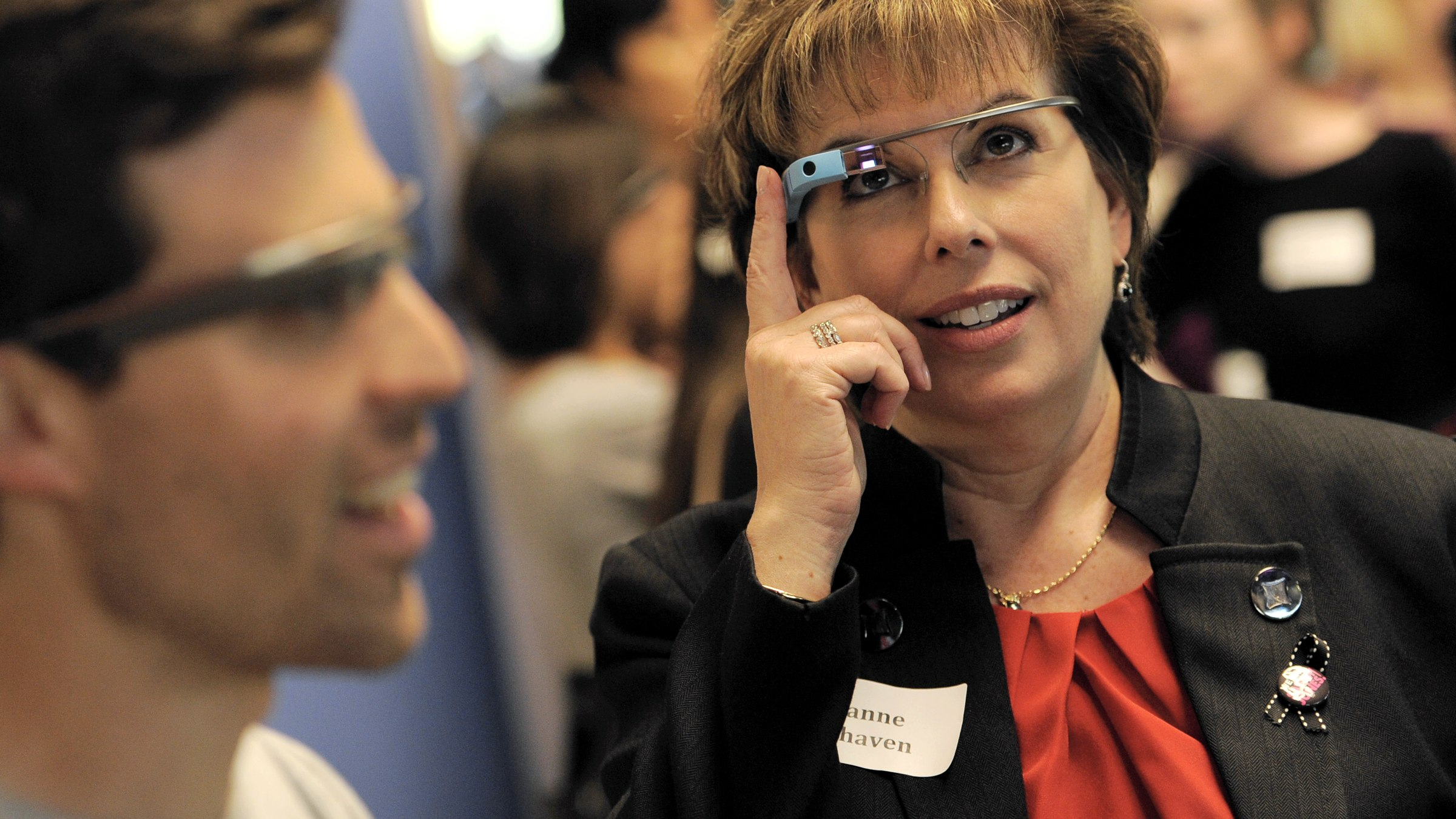 IMAGES DISTRIBUTED FOR THE TELEVISION ACADEMY - Academy of Television Arts and Sciences member Ilyane Morden Kichaven, right, gets a lesson on Google Glass with Google's Sami Tahari at the YouTube Space L.A. Tour and Happy Hour, on Friday, March 7, 2014 in Los Angeles. (Photo by Chris Pizzello/Invision for the Television Academy/AP Images)