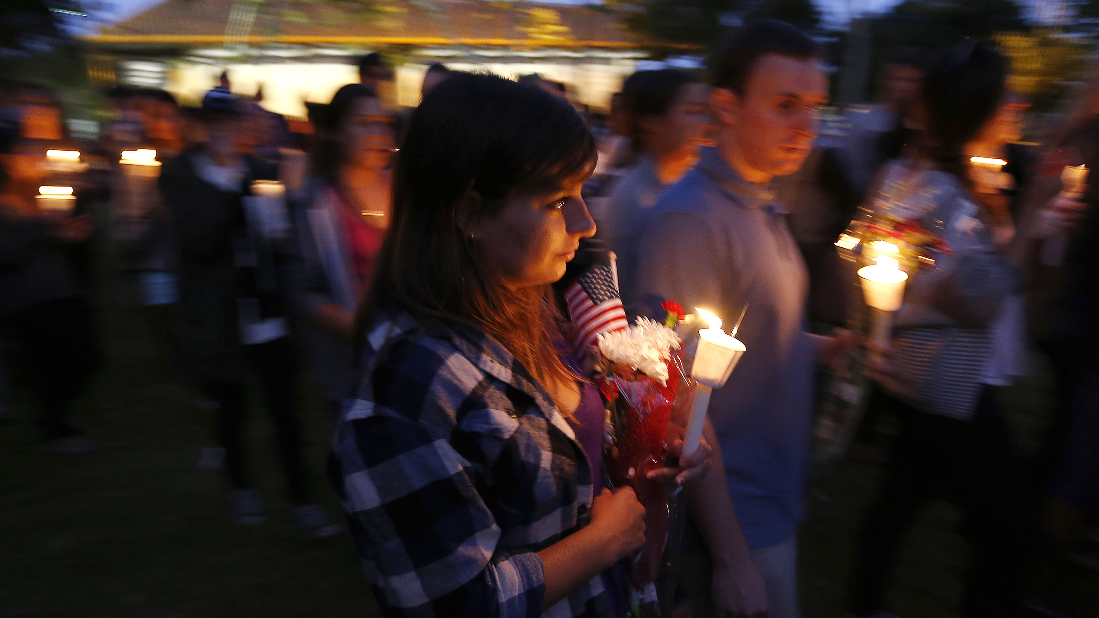 UC Santa Barbara students attend a candlelight march and vigil following Friday's series of drive-by shootings that left seven people dead in the Isla Vista section of Santa Barbara May 24, 2014. A lone gunman sprayed bullets from a car in a drive-by shooting in a southern California college town, killing at least six people before his car crashed and he was found dead inside, authorities said on Saturday. REUTERS/Jonathan Alcorn