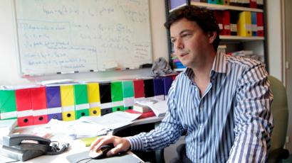 Thomas Piketty, French economist, works in his office in Paris April 11, 2012. At 40, Piketty is one of France's top economists and has won international acclaim for his pioneering work about income inequality worldwide. Picture taken April 11, 2012.