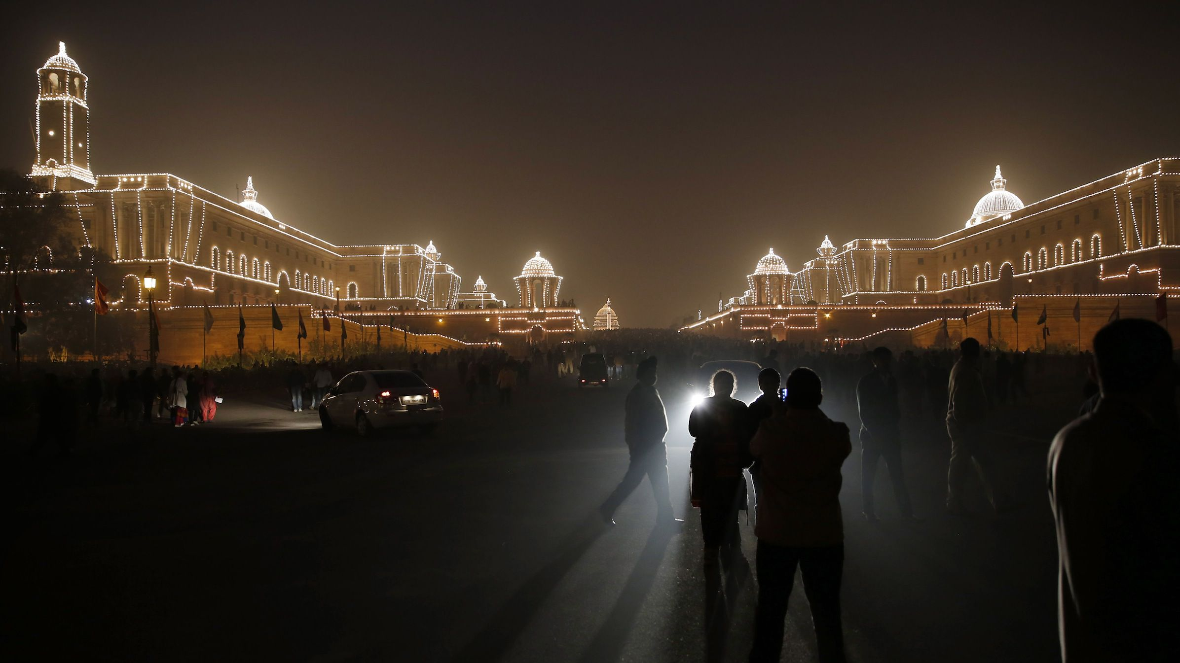 Indians take a tour of an illuminated Raisina Hill, which houses India's most important ministries and the presidential palace, after the Beating Retreat ceremony in New Delhi, India, Wednesday, Jan. 29, 2014. The ceremony marks the end of Republic Day celebrations. (AP Photo /Manish Swarup)