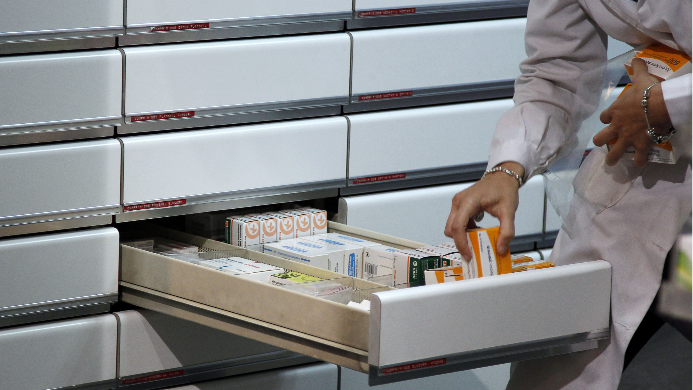 A chemist places medicines in a drawer at a pharmacy in Madrid April 18, 2012. Spain's government met regional officials on Wednesday to agree ways to cut state healthcare, an attack on a treasured welfare system that will fuel anger among a population weary of EU-enforced austerity to tackle a ballooning deficit. The conservative government has warned Spaniards they would have to start paying more for prescriptions, part of the welfare system that has provided state-financed health and education since the country's transition to democracy began in the 1970s.