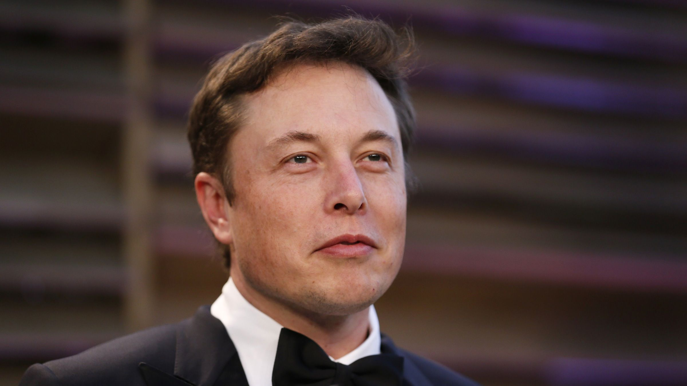 Chief Executive of SpaceX and Tesla Motors Elon Musk arrives at the 2014 Vanity Fair Oscars Party in West Hollywood, California March 2, 2014. REUTERS/Danny Moloshok (UNITED STATES  - Tags: ENTERTAINMENT BUSINESS)(OSCARS-PARTIES) - RTR3FY5P