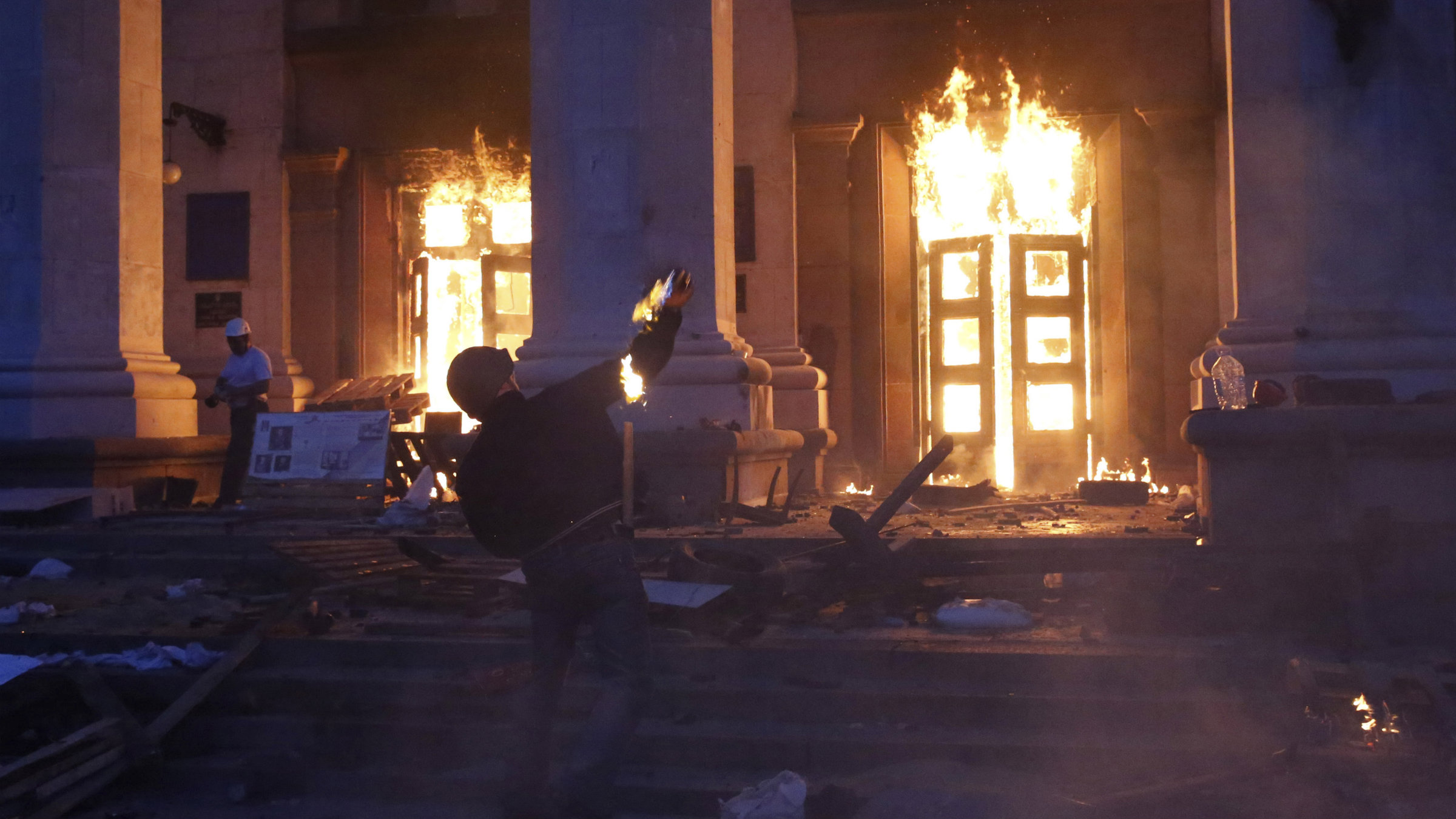 A protester throws a petrol bomb at the trade union building in Odessa on May 2.