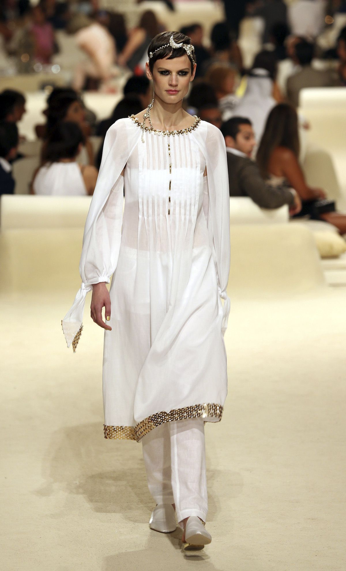 A model presents a creation from Chanel's 2014/15 Cruise collection in Dubai
