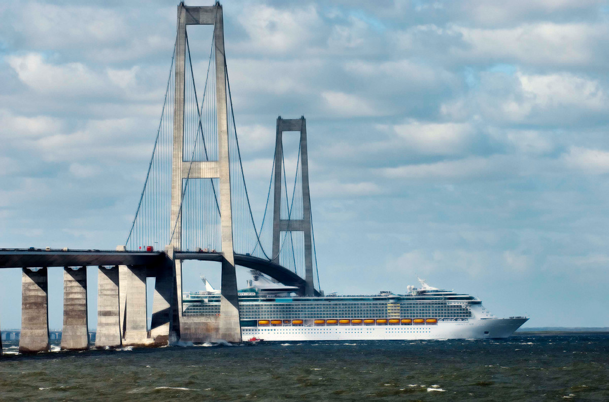 The cruise ship Liberty of the Seas passes under the Danish bridge Storebaeltsbroen, as the cruise ship sailed past Storebaelt in Denmark on her way from Finland to Southampton in England on Friday, April 20, 2007. Liberty of the Seas is actually two meters higher than the bridge, but was just able to pass under it on Friday due mainly to a low tide.