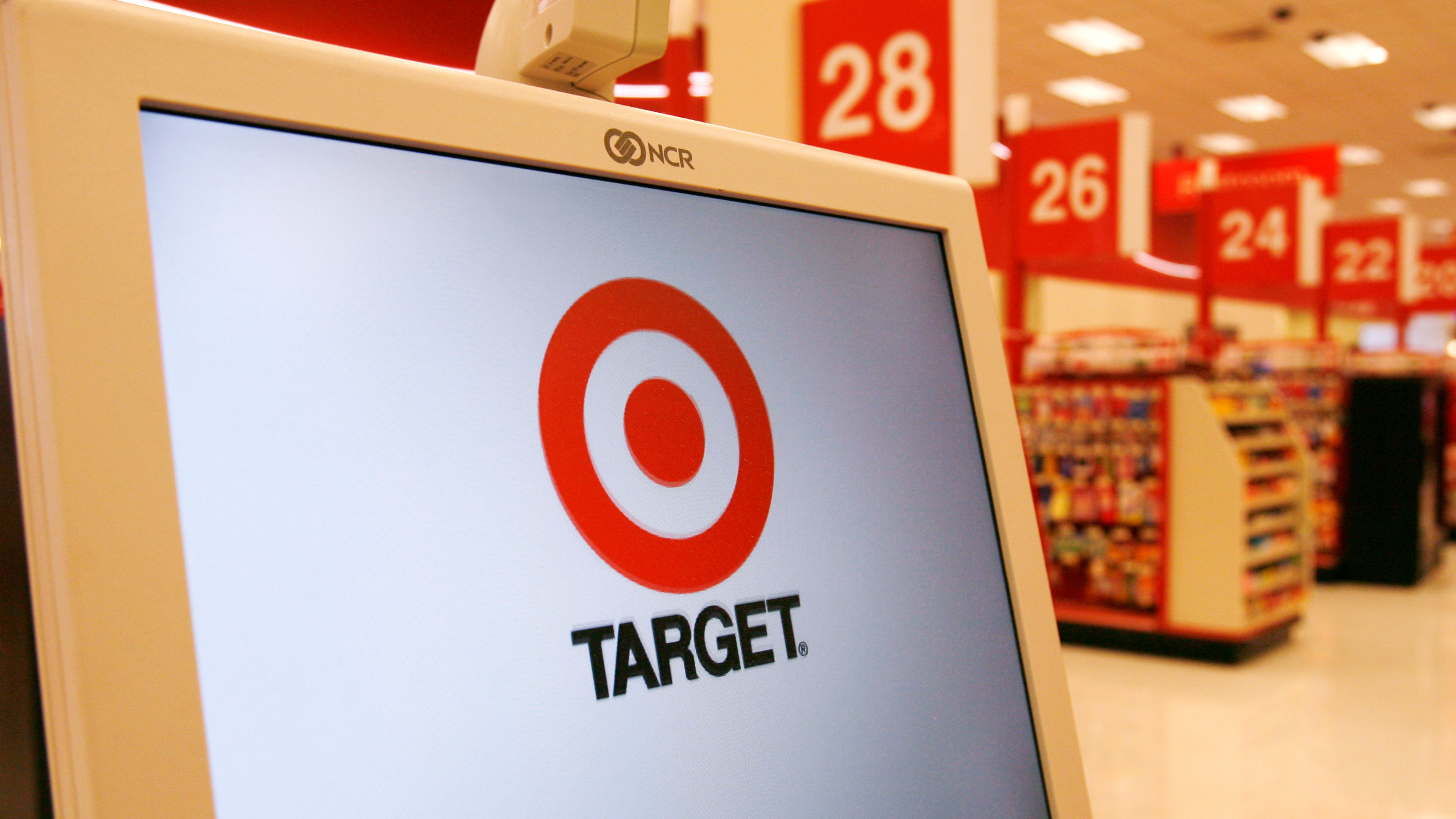 A Target company logo is displayed on a cash register in a Target store in Falls Church, Virginia August 19, 2008. Target Corp reported a nearly 8 percent drop in quarterly profit on Tuesday as shoppers passed over trendy clothes and home decor in favor of everyday necessities, hurting its margins. REUTERS/Kevin Lamarque (UNITED STATES)