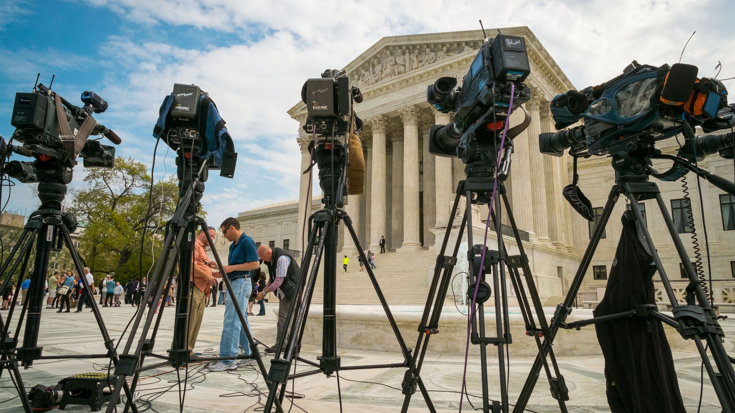 TV cameras outside the US Supreme Court during arguments in the Aereo case