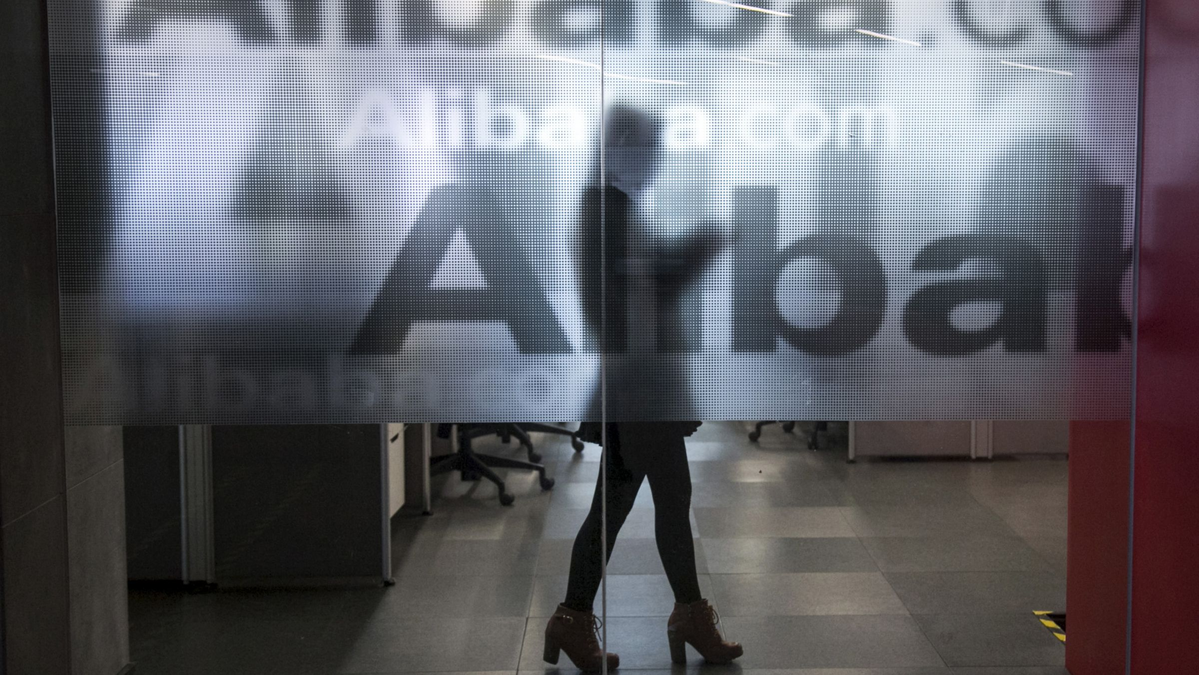DATE IMPORTED:An employee is seen behind a glass wall with the logo of Alibaba at the company's headquarters on the outskirts of Hangzhou, Zhejiang province, April 23, 2014. Alibaba Group Holding Ltd's planned IPO is set to create a long list of multi-millionaires just from its partners in the company - music to the ears of private bankers seeking to cash in on the wealth created by China's tech sector boom. Picture taken April 23, 2014. REUTERS/Chance Chan