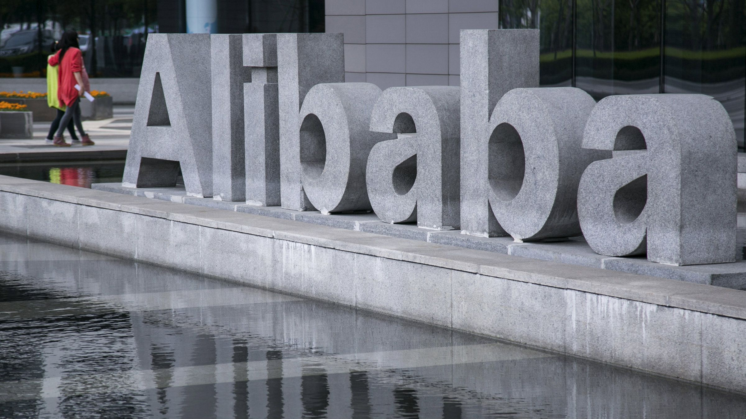 People walk at the headquarters of Alibaba in Hangzhou, Zhejiang province, April 23, 2014. A