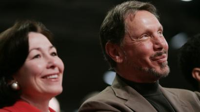 Oracle CEO Larry Ellison and CFO Safra Catz smile during a conference in San Francisco.