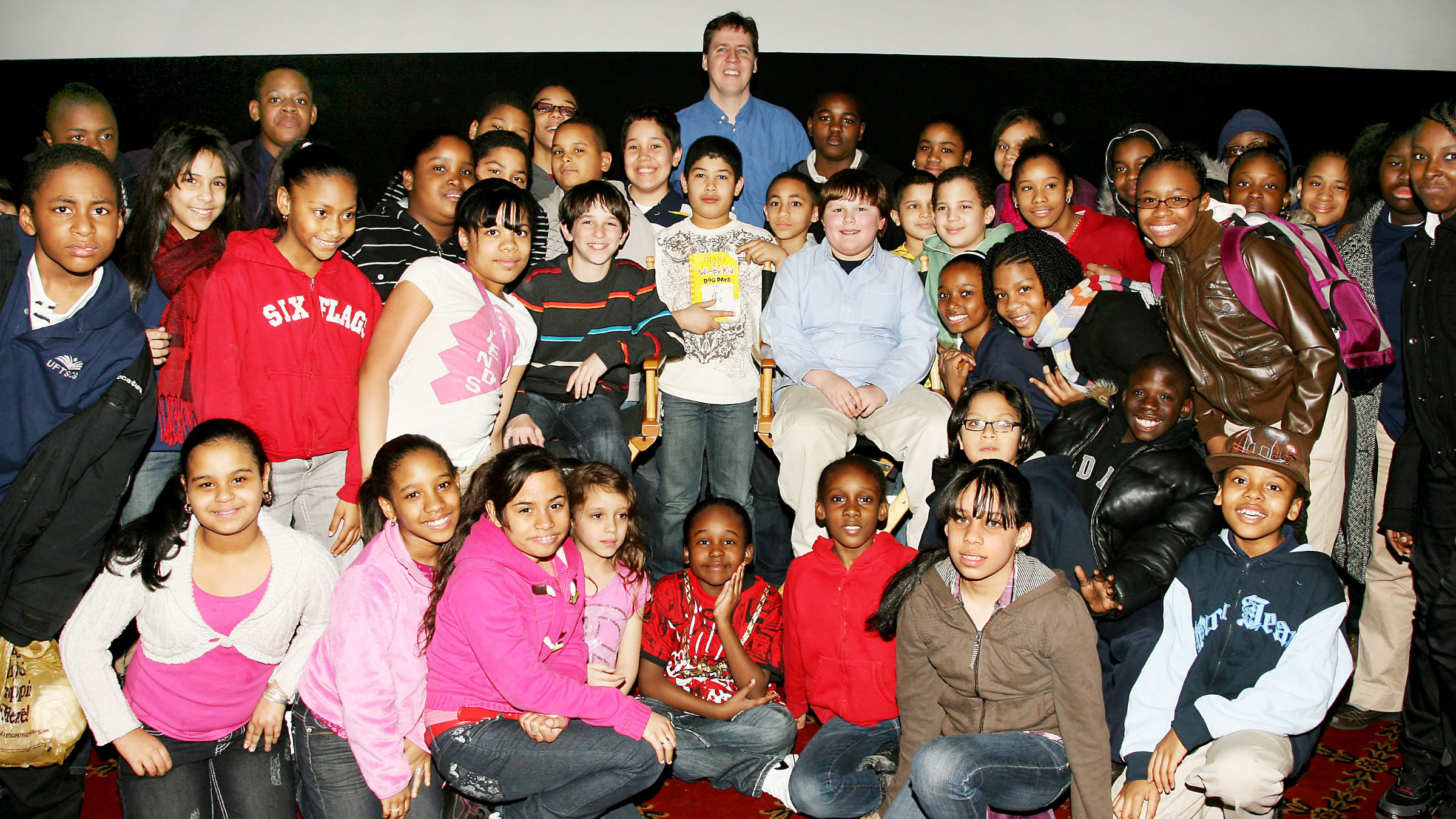 """In this photo provided by StarPix, Author Jeff Kinney and the cast of 20th Century Fox's """"Diary of a Wimpy Kid"""" attend a special screening of the film in New York, Thursday, March 4, 2010."""