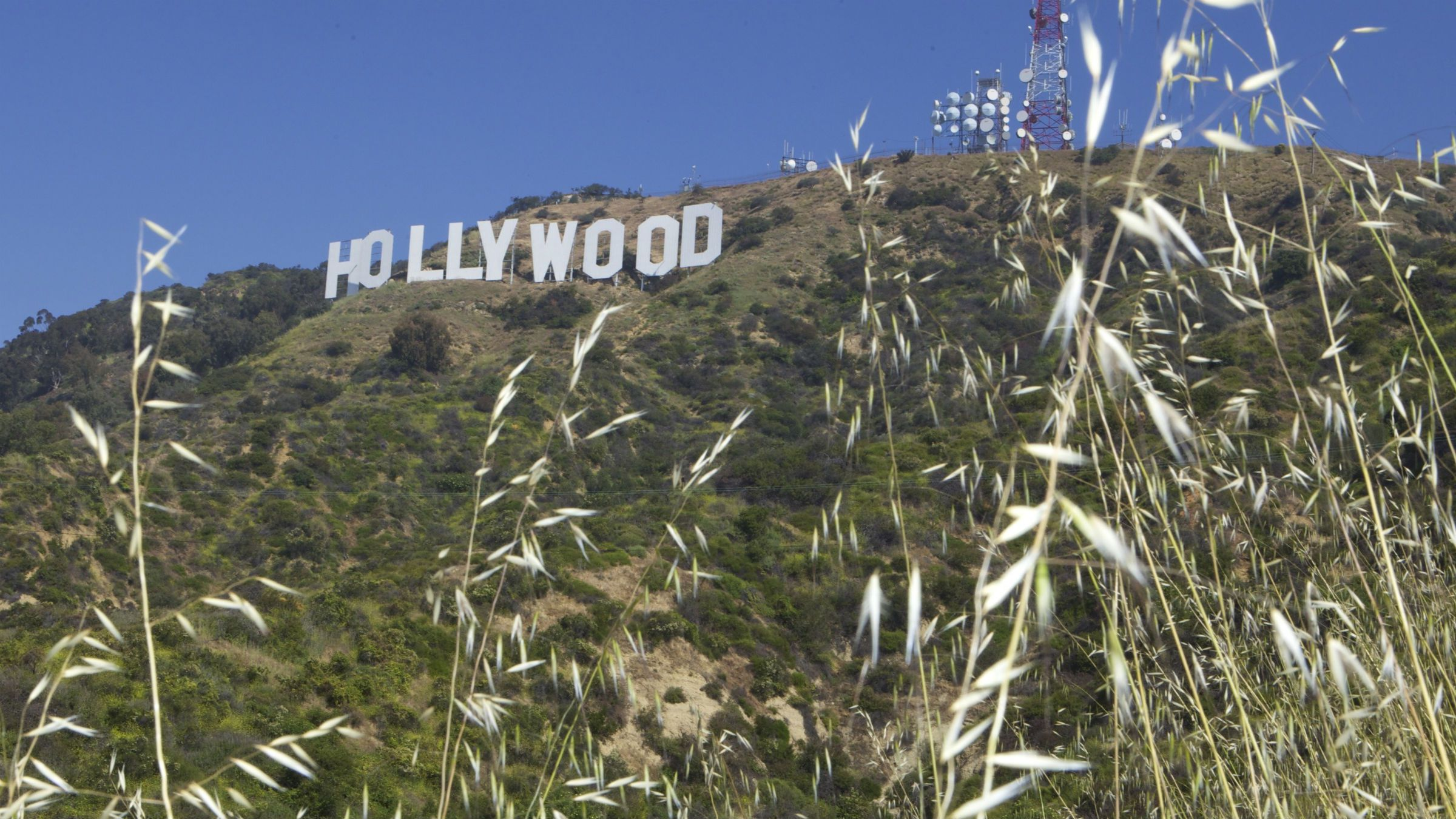 """The Hollywood sign is seen on Monday, April 26, 2010, in Los Angeles. Officials with the Trust for Public Land announced the success of the """"Save the Cahuenga Peak"""" campaign, after raising $12.5 million to acquire a 138-acre parcel of land just west of the landmark Hollywood sign. A final $900,000 donation by Playboy founder Hugh Hefner completed the $12.5 million fundraising drive to protect the 138 acres behind the famous sign."""