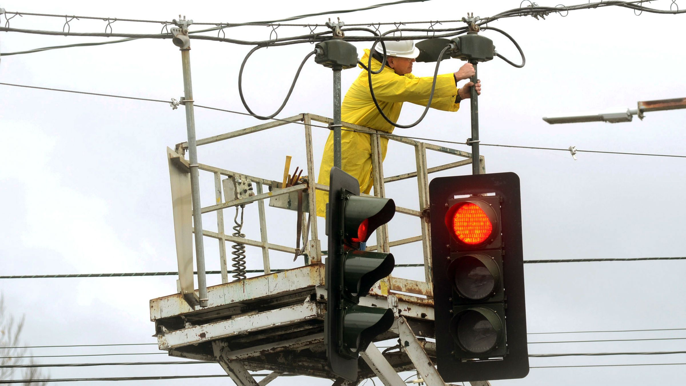 Electrician-fixes-traffic-light