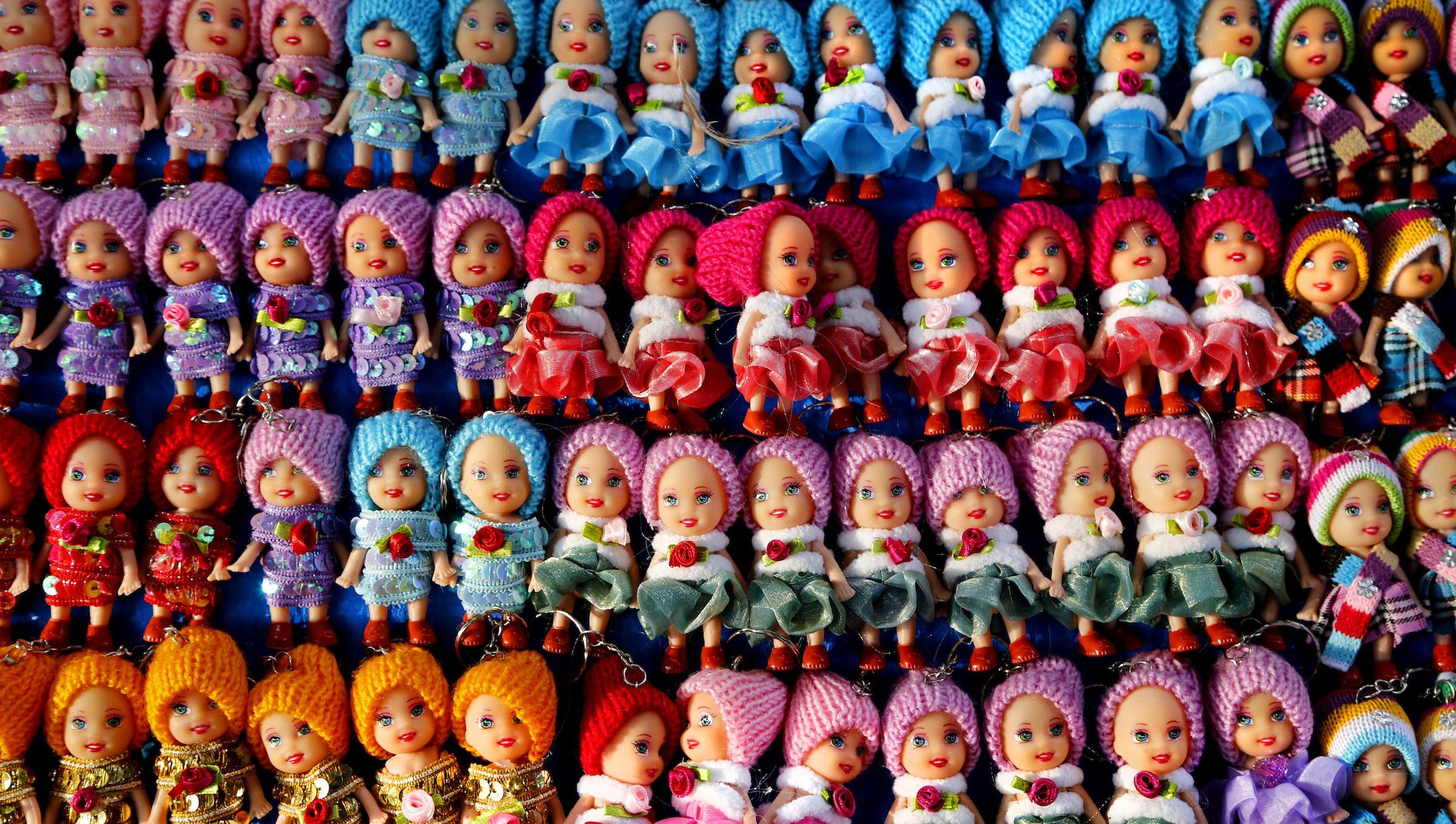 In this Sunday, Dec. 22, 2013, photo, key chains in the shape of dolls are displayed in a shop, in Mumbai, India. Mumbai, which is also known as financial capital of India is the fourth most populous city in the world. (AP Photo/ Rajesh Kumar Singh)