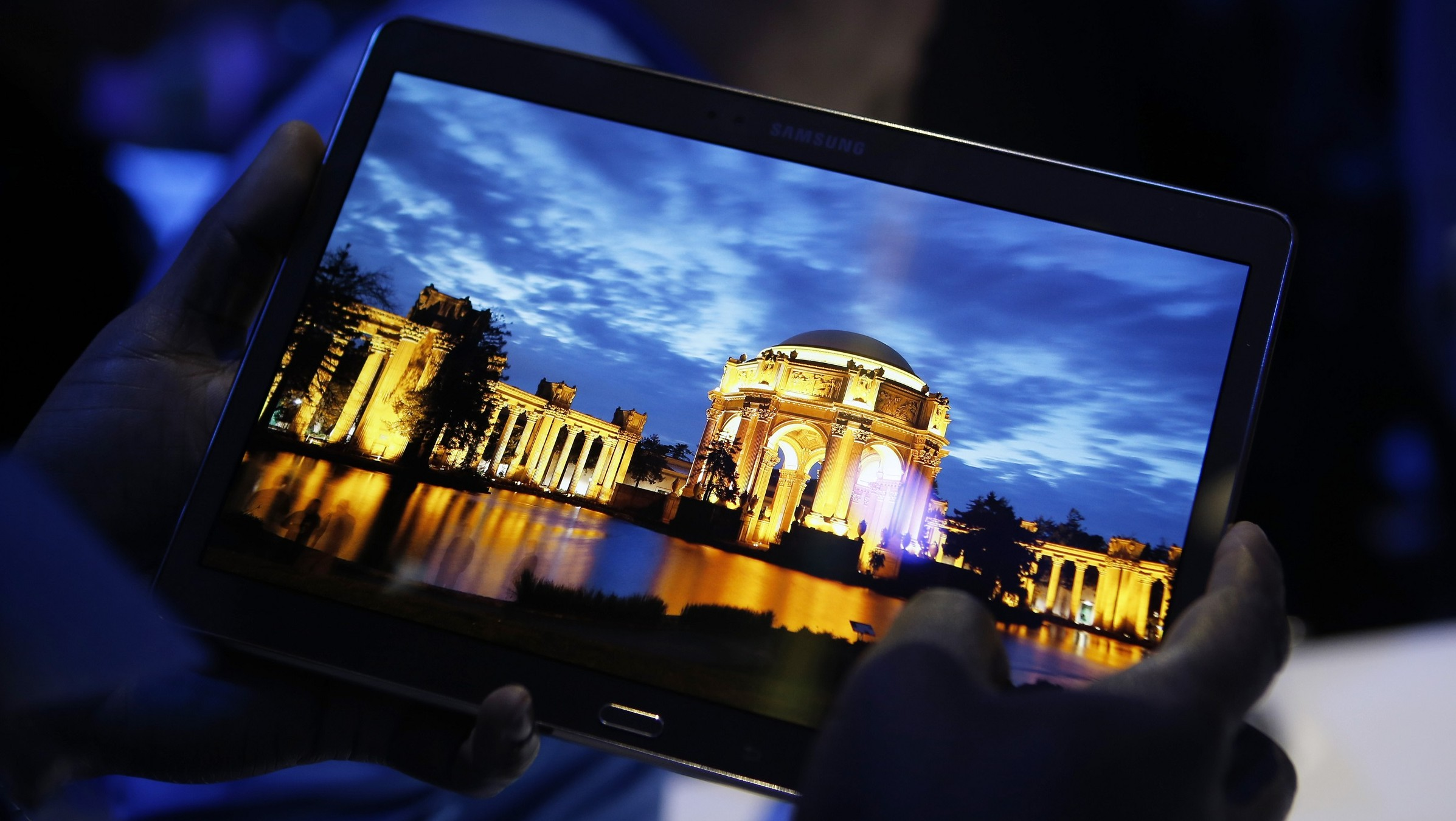 A member of the media tries out a new Samsung Galaxy Tab S after the tablet's debut at a press conference in New York, Thursday, June 12, 2014. New tablet computers from Samsung will feature screens that are richer in color than standard LCDs. (AP Photo/Kathy Willens)