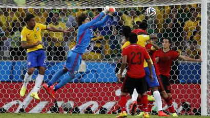 Mexico's Ochoa catches ball in match with Brazil