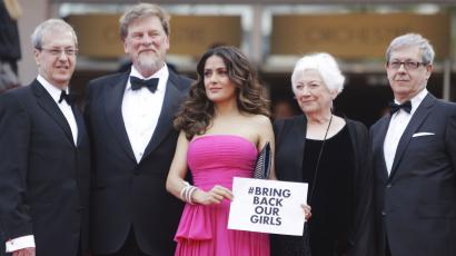 Salma Hayek in Cannes holds #bringbackourgirlssign