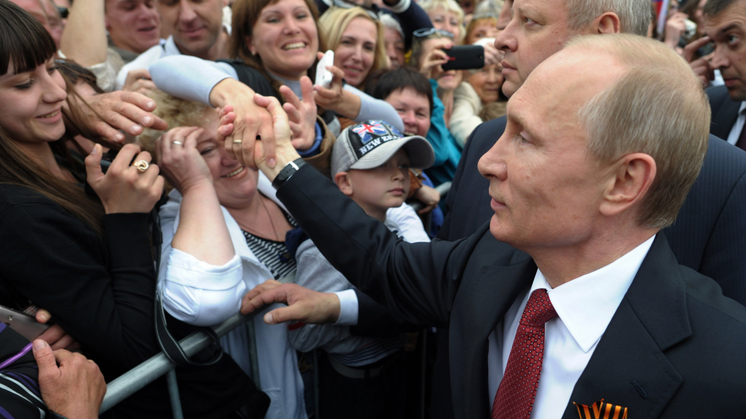 Russian President Vladimir Putin is greeted by people in Sevastopol where he attends celebrations marking Victory Day.