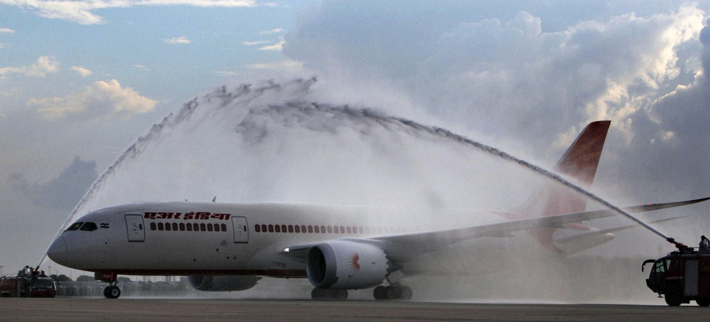 A Boeing 787 Dreamliner passenger plane receives a water canon salute upon arrival at the Indira Gandhi International Airport in New Delhi, India, Saturday, Sept. 8, 2012. Air India has taken delivery of its first Boeing 787 from the company. It is the fifth airline worldwide to take delivery of a 787 and has 26 more on order. (AP Photo)