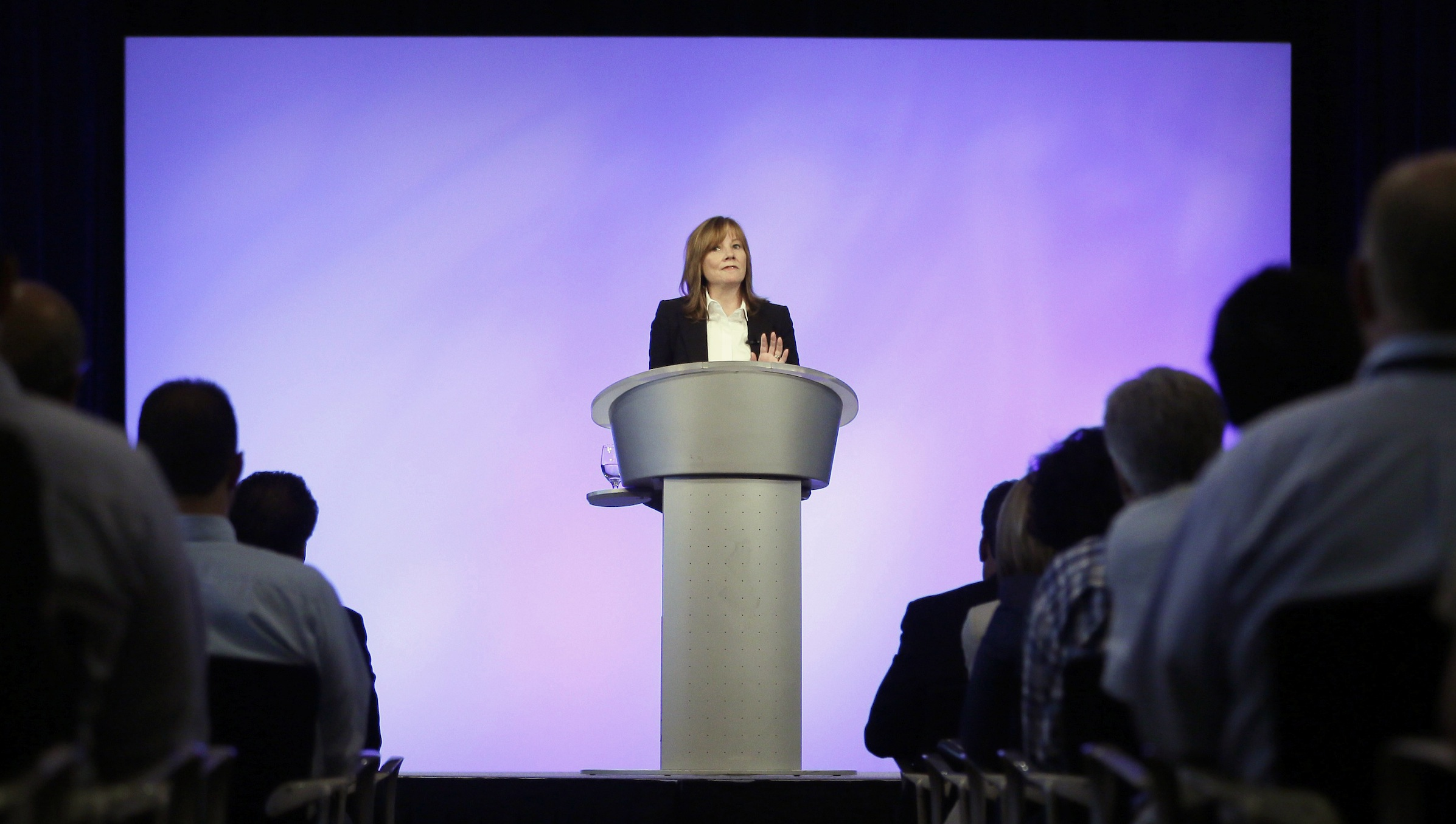 General Motors CEO Mary Barra addresses employees at the automaker's vehicle engineering center in Warren, Mich., Thursday, June 5, 2014. Barra said 15 employees have been fired and five others have been disciplined over the company's failure to disclose a defect with ignition switches that is now linked to at least 13 deaths. (AP Photo/Carlos Osorio)