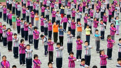 Beijing primary school chidren do organized exercises.