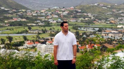 "Former U.S. citizen Adam Bilzerian stands on a hilltop overlooking part of Basseterre January 31, 2012. Bilzerian, son of former corporate raider Paul Bilzerian, renounced his U.S. citizenship in 2008 after becoming disenchanted with its politics and acquiring a St. Kitts and Nevis passport through a ""citizenship by investment"" program. This two-island nation is one of three countries offering so-called citizenship by investment, burgeoning programs that bestow on foreigners the benefits of being a citizen - namely, a passport for a price. Picture taken January 31."