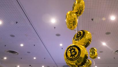 "Bitcoin themed balloons float in the air during the ""Inside Bitcoins: The Future of Virtual Currency Conference"" in New York"