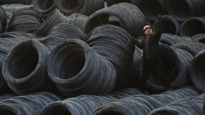 china slowdown economy gdp DATE IMPORTED:April 23, 2014A labourer works on piles of steel coils in Taiyuan, Shanxi province, February 22, 2013. China's factory activity shrank for the fourth straight month in April, signalling economic weakness into the second quarter, a preliminary survey showed on April 23, 2014, although the pace of decline eased helped by policy steps to arrest the slowdown. Picture taken February 22, 2013. REUTERS/Jon Woo