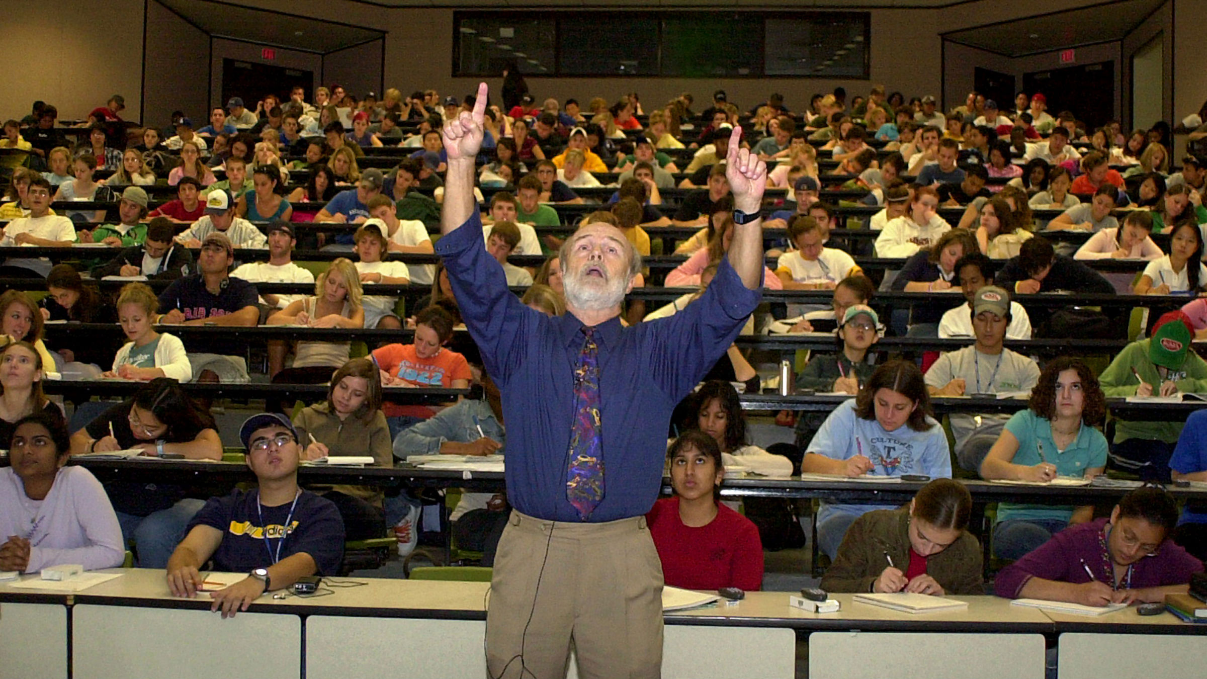 Professor lecturing in college lecture hall