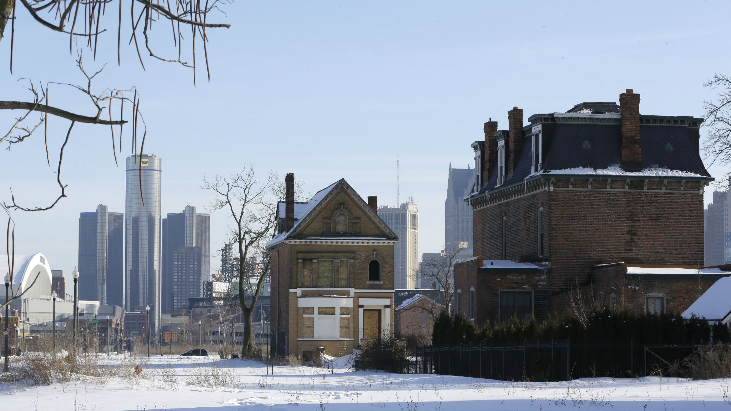 View of downtown Detroit behind some abandoned buildings.