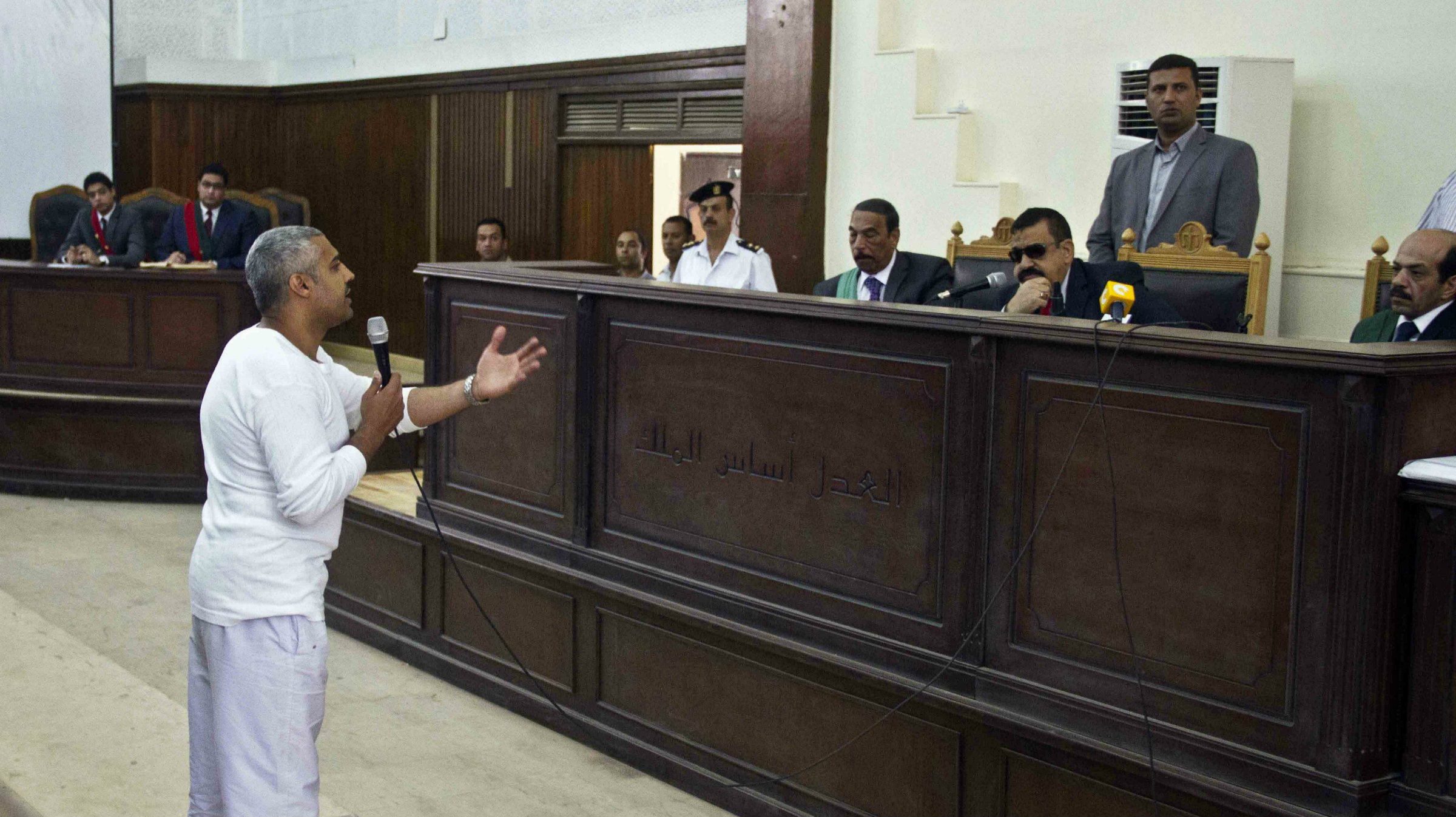 Al Jazeera defendant talks to the judge.