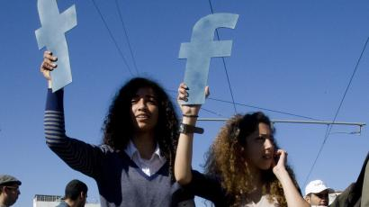 "Protesters hold ""f""s in recognition of social network site Facebook's role in the North African revolts, during a protest in Rabat."