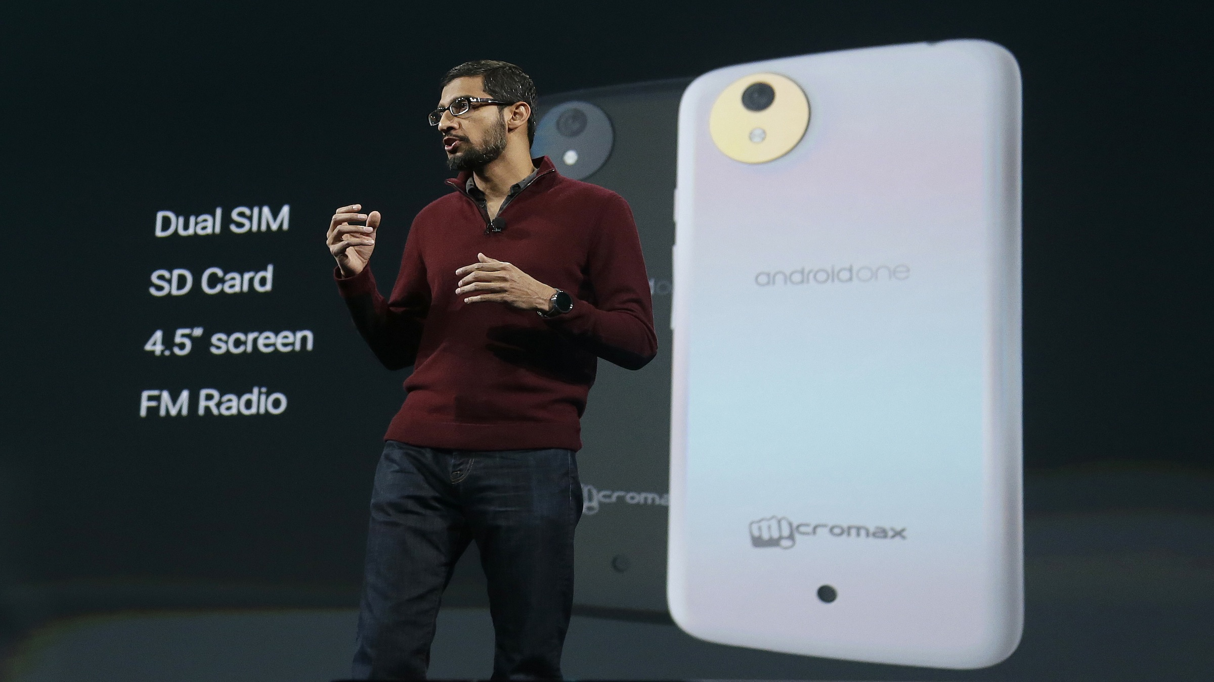 Sundar Pichai, senior vice president of Android, Chrome and Apps, speaks about the Android One phone during the Google I/O 2014 keynote presentation in San Francisco, Wednesday, June 25, 2014. As the Internet giant's Android operating system stretches into cars, homes and smartwatches, this year's annual confab will expand on its usual focus on smartphones and tablets. (AP Photo/Jeff Chiu)