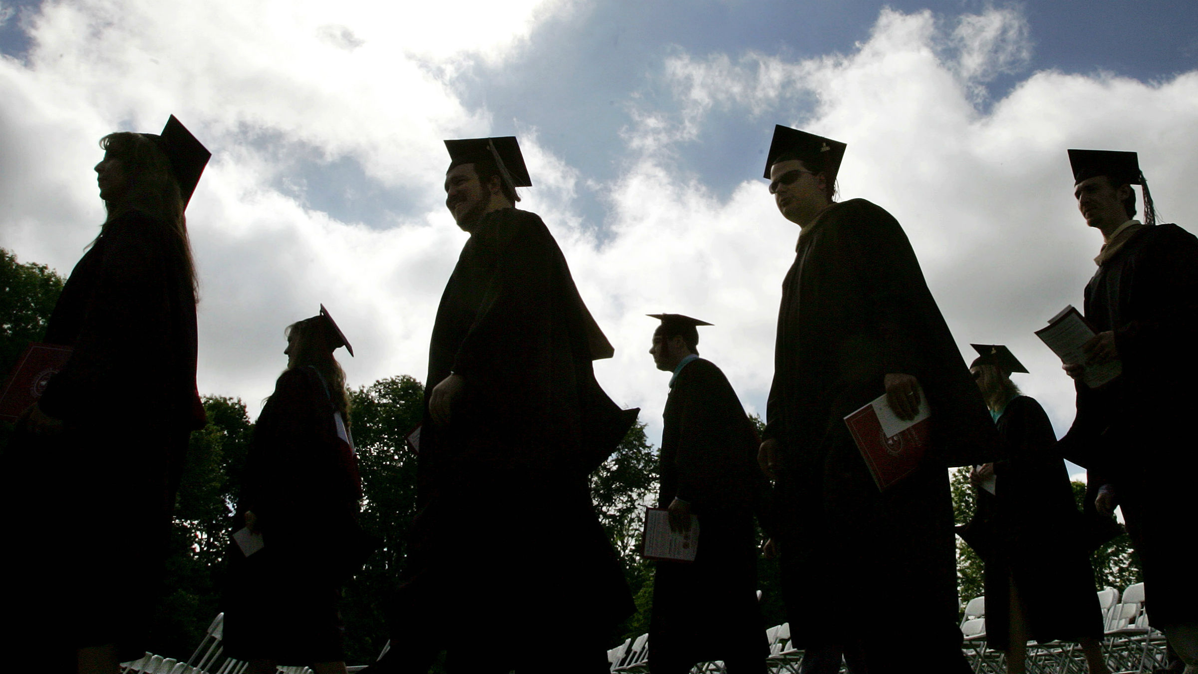 Rider University students in their caps and gowns are silhouetted as they line up for graduation ceremonies Friday, May 12, 2006, in Lawrenceville, N.J.. New York Yankees manager Joseph P. Torre and wife Alice W. Torre received honorary degrees from the school.