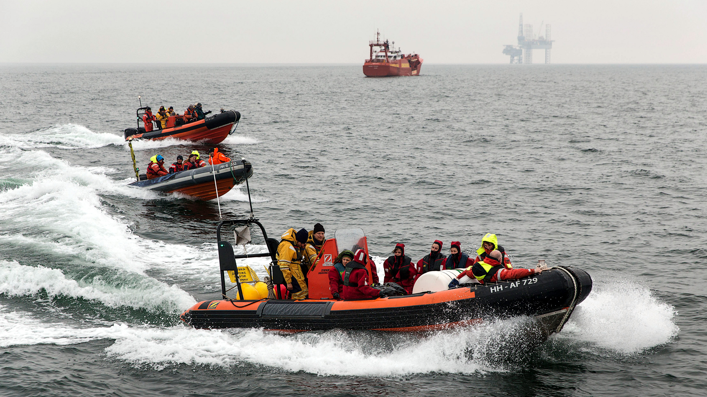 Greenpeace members speed up in a rubber speedboat while waiting for the Russian oil tanker Mikhail Ulyanov off the coast of the Hague April 30, 2014. Environmental group Greenpeace has dispatched one of its campaigning vessel to block the Mikhail Ulyanov, an oil tanker owned by Russia?s state oil firm Gazprom loaded with the first cargo of Arctic oil from the Prirazlomnaya platform.