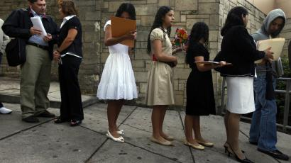 Hondurans wait in line to apply for visas to the US.